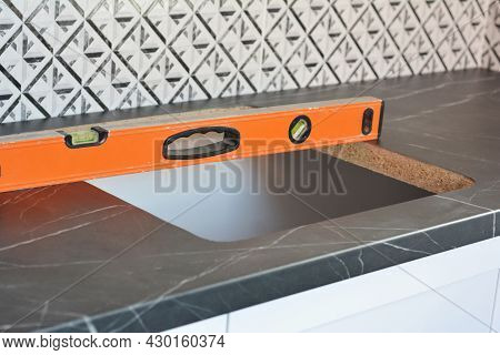 Kitchen Sink Installation. A Close-up Of A Kitchen Worktop With A Hole For Sink Installation And A S
