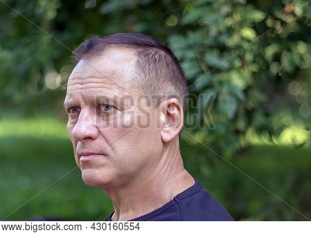 Courageous Attractive Middle-aged Man, Against The Background Of Nature, Male Portrait Of A Man With