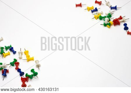 Scattered Thumbtack Pins In The Corner On White Background With Text Space