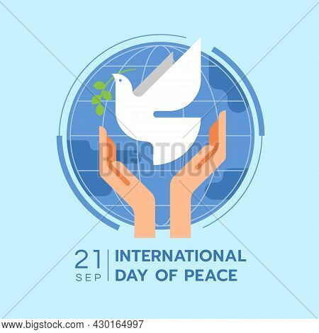 International Day Of Peace - Hands Are Letting The Dove Of Peace To Fly On Blue Circle World On Soft