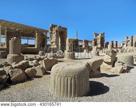 Close Up View Onto Remains Of Columns And Constructions Of Palace Of 100 Columns, Located In Persepo