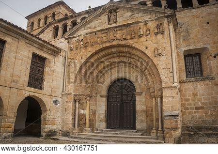 Main Facade View Of The Romanesque Collegiate Church Of Santillana Del Mar In Cantabria In Spain.