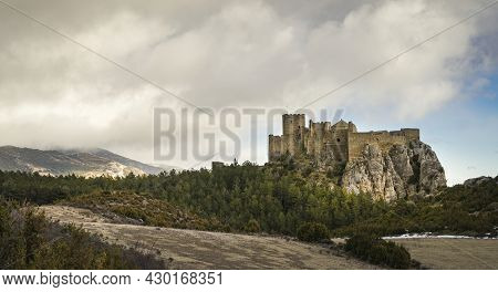 Panoramic View At Sunset Of The Medieval Romanesque Abbey Castle Of Loarre In The Province Of Huesca