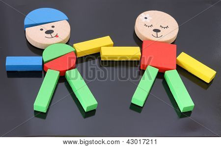 Colorful figures made from set of toy blocks