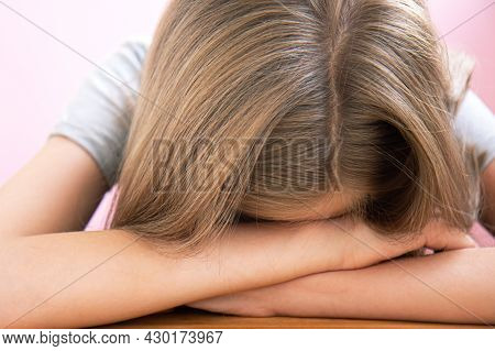 Tired Student Preparing For Exams On Light Pink Background With Copy Space