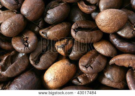Dark whole coffee beans background