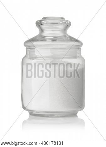 Front view of  refined granulated sugar in glass jar isolated on white