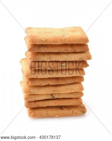 Front view of stacked salted crackers with rosemary isolated on white
