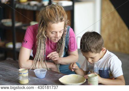 Workshop For Kids. Children Learning How To Use Clay For Making Beautiful Dishes. Workshop, Master C