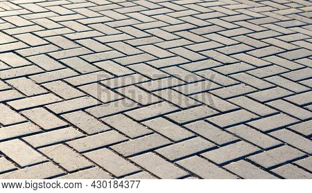 Paving Tiles Of Gray Color Laid Geometrically Correct Pattern For Walking In The Fresh Air