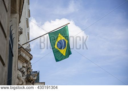 Brazil Flag. Brazilian Flag Displaying On A Pole In Front Of The House. National Flag Of Brazil Wavi