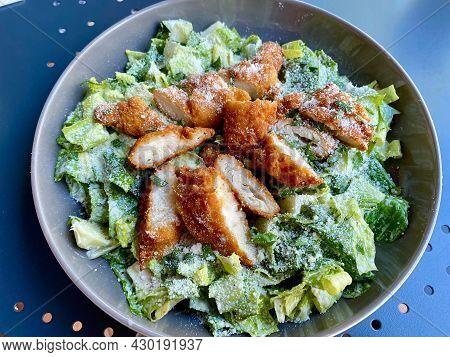 Healthy Organic Caesar Salad With Chicken, Parmesan Cheese, Yogurt And Mayonnaise Sauce.