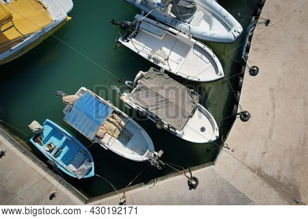 Aerial Drone View Of Fishing Boats Moored At The Harbor. Agia Triada Paralimni Cyprus