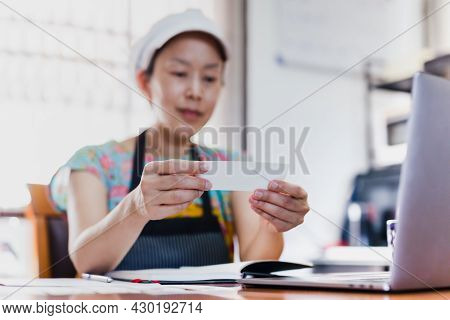 Sme Chef Woman Reding Greeting Card Wearing Apron And Hat