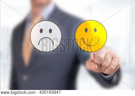 Close Up Customer Hand Choose Smiley Face Icon. Businessman Hand Pointing The Optimist Icon From Scr