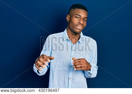 Young african american man wearing casual clothes disgusted expression, displeased and fearful doing disgust face because aversion reaction. with hands raised