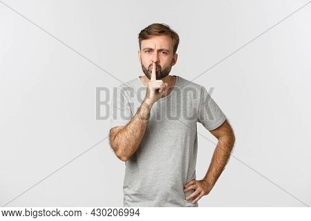 Angry Bearded Man In Grey T-shirt, Hushing And Frowning, Scolding Person For Talking Too Loud, Stand