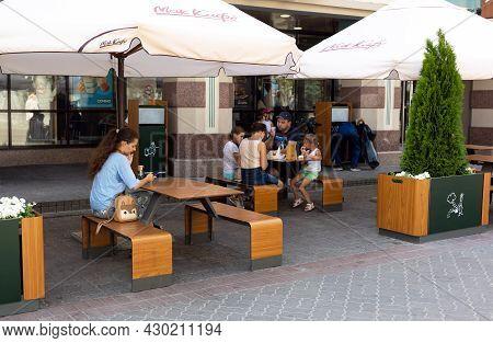 Kazan, Russia, 20 July 2021 - People Eating Fastfood In Mcdonalds Fast Food Restaurant