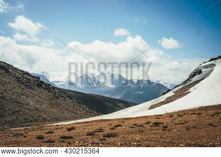 Scenic Highlands Landscape With Glacier On Hills On Background Of Large Snowy Mountain With Peaked T