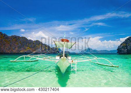 Traditional Filipino Boat Bangka Or Banca In El Nido Province, Palawan Island In Philippines