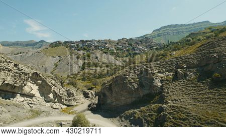 Top View Of Old Mountain Settlement. Action. Green Mountain Landscape With Houses And Settlement. Mo