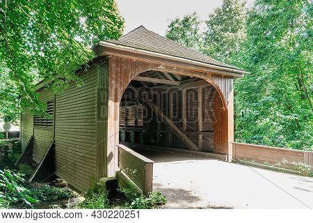 Historical Wooden Covered Bridge Built In 1840 Over Zdobnice River,near Village Of Peklo,czech Repub