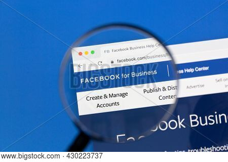 Ostersund, Sweden - Feb 4, 2021: Facebook business page under a magnifying glass. Facebook is the most visited social network in the world