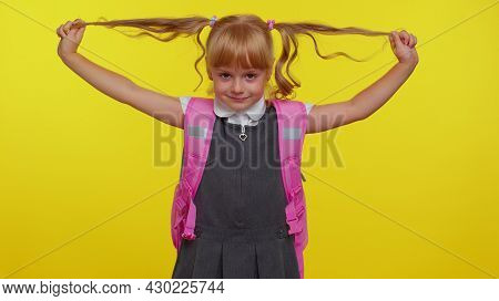 Happy Girl Kid In School Uniform, Play With Pony Tails Laugh Fooling Around Showing Tongue Making Pl