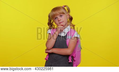 Thoughtful Clever Cute Teenage Girl Dressed In School Uniform Rubbing Her Chin And Looking Aside Wit