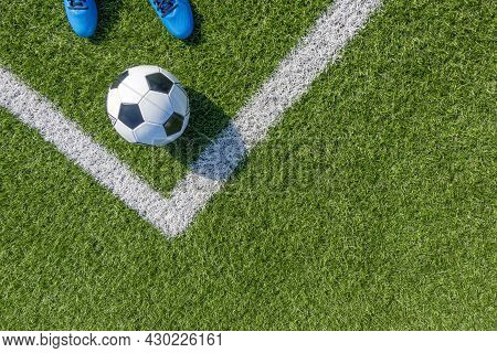 Soccer Football Background. Soccer Ball And Pair Of Football Sports Shoes On Artificial Turf Soccer