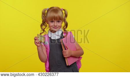 Cheerful Funny Blond Teenage Schoolgirl Kid In Uniform Hold In Hand Bank Credit Card Showing Thumbs