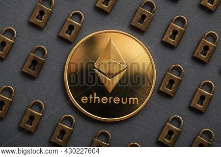 Ethereum Coin With Padlock On Black Background. Ethereum Security. Digital Cyber Safety Or Security