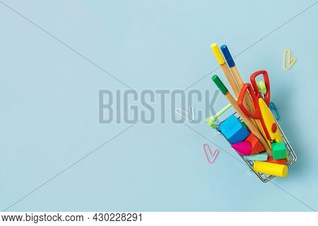 School Supplies And Paper Clip On A Blue Background. Back To School Concept. Precautions For Covid-1
