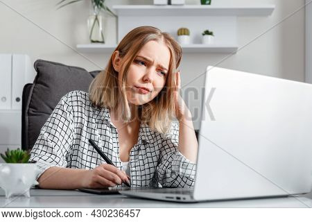 Dissatisfied Upset Tired Woman Works With Headaches In Stress Using Graphics Tablet Laptop In Office
