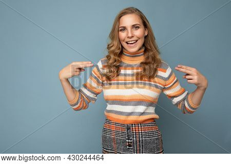 Young Charming Fascinating Sexy Positive Happy Smiling Blonde Woman Wearing Casual Striped Pullover