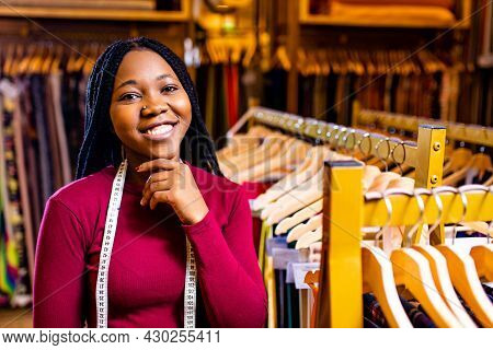 Dark Skinned Business Woman Salewoman Working At Textile Shop