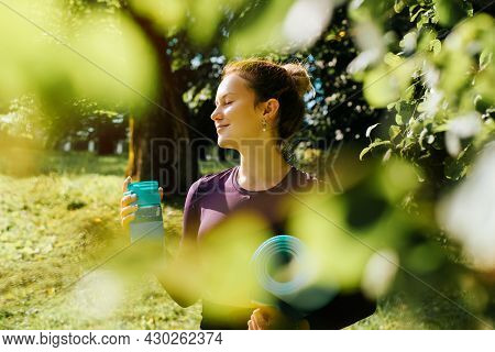 Portrait Of Smiling Young Sportive Woman With Closed Eyes Enjoying Nature And Sunny Morning, Sportsw