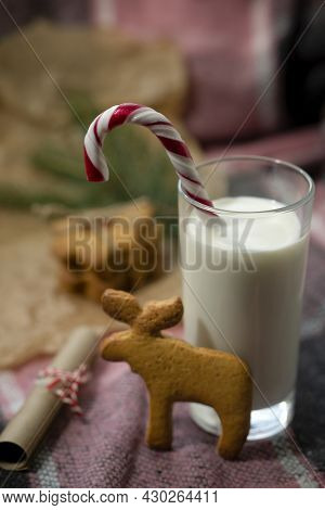 Santa Claus Present For Christmas. A Glass Of Milk And Cookies With Almonds Waiting For My Grandfath
