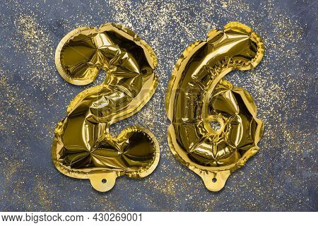 The Number Of The Balloon Made Of Golden Foil, The Number Twenty-six On A Gray Background With Sequi