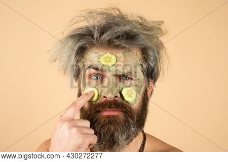 Funny Man Face With Clay Mask And Cucumber Slices On Face. Spa, Dermatology, Wellness And Facial Tre