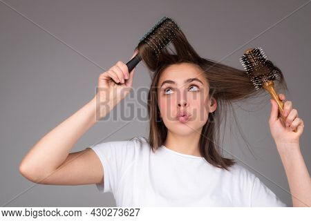 Funny Woman Combs Her Healthy Hair. Combing Healthy Long Straight Female Hair, Close Up. Attractive