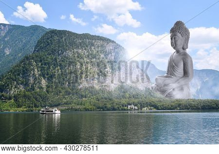 Majestic Buddha Sculpture Near Lake And Mountains On Sunny Day