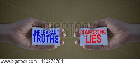 Unpleasant Truths Versus Conforting Lies On Cardboards In Man's Hands, Concept For Different Choices