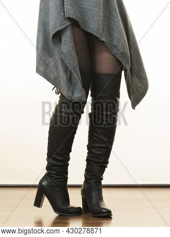 Unrecognizable Woman Wearing Gray Long Top Sweater Tunic, Black Tights. Stylish, Autumnal Outfit.