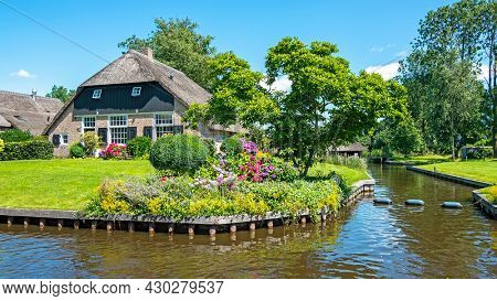 Traditional old farmers house on a beautiful summer day in the countryside from the Netherlands
