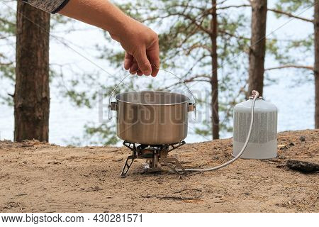 Tourist Foods In Outdoor Activities. Food In Bowler In The Green Forest. Camping Food Making.