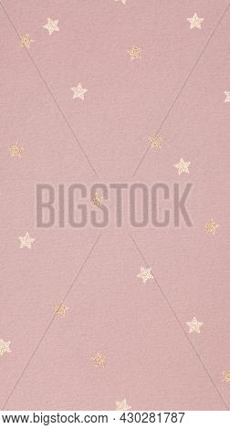 Gold star pattern on a pink background