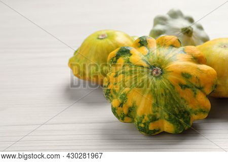 Fresh Ripe Pattypan Squashes On White Wooden Table, Closeup. Space For Text