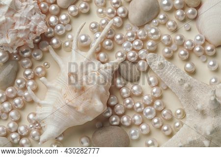 Beautiful Sea Shells, Starfish, Pebbles And Pearls On Beige Background, Flat Lay