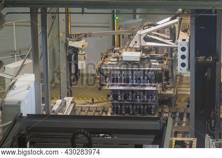 Nizhny Novgorod, Russia - January 6, 2021: Amstel Brewery. Robotic Palletizer Working With Plastic B